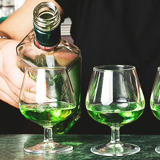 absinthe mixing with bottle