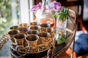 Bar cart with vintage mint julep cups