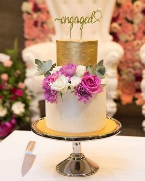 """Cake with """"Engaged"""" cake topper"""