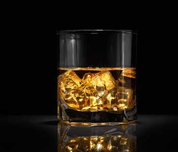 A glass of fancy bourbon on the rocks