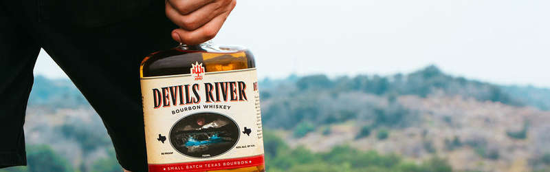 Devils river whiskey holding bottle