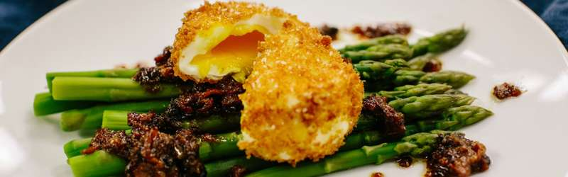 Asparagus with crispy poached eggs and warm bacon vinaigrette 1584x946 ramona king