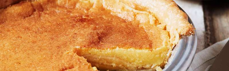 A freshly sliced buttermilk pie