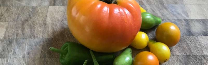 Heirloom tomatoes and peppers on board