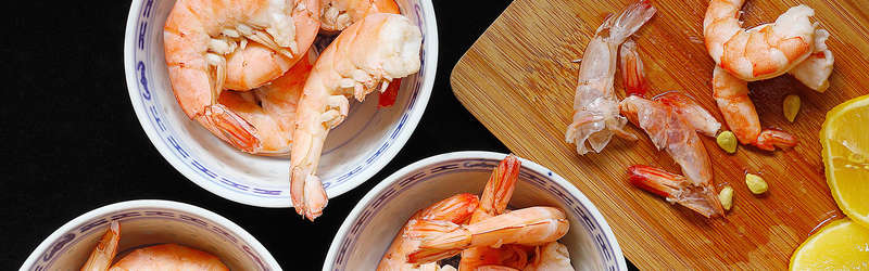 Cooked shrimp dressed with lemon juice in china bowls 4460x4460