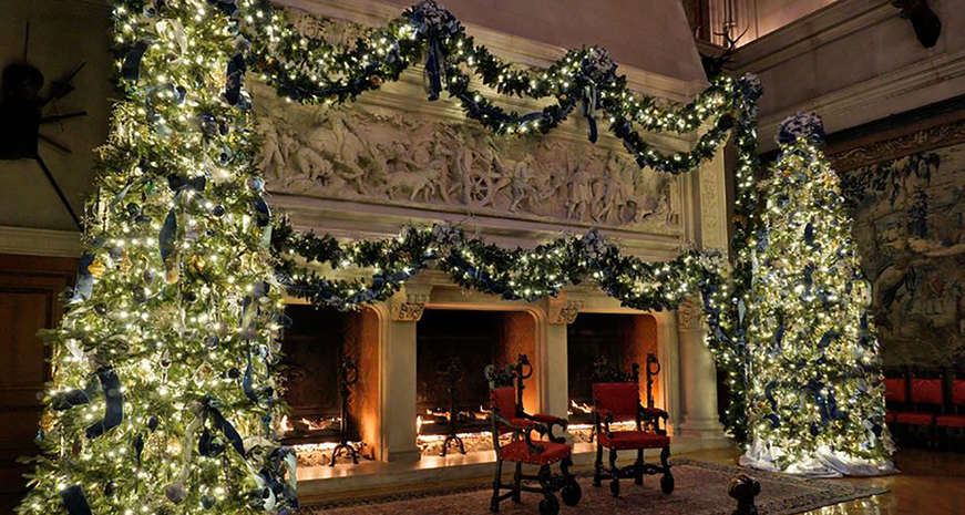 The Banquet Hall's three fireplaces lit for Candlelight Christmas Evenings at Biltmore