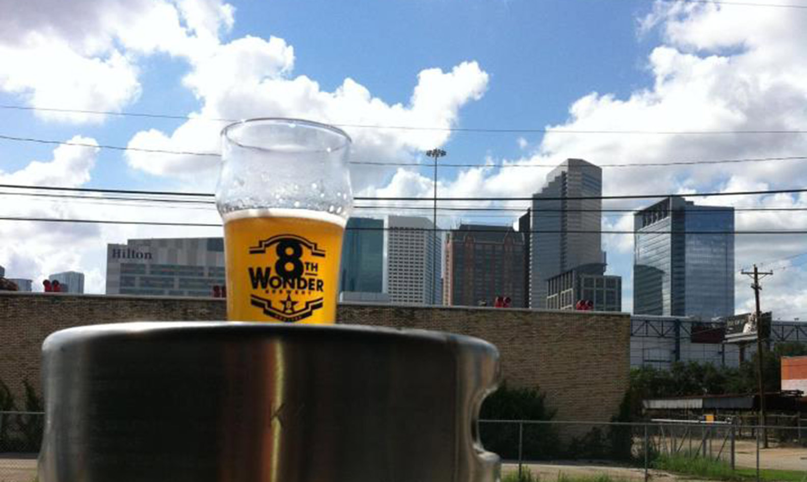 An 8th Wonder beer overlooking the Houston skyline