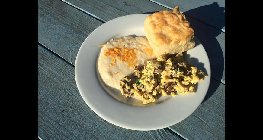 Mama's Boy biscuits with grits and scrambled eggs