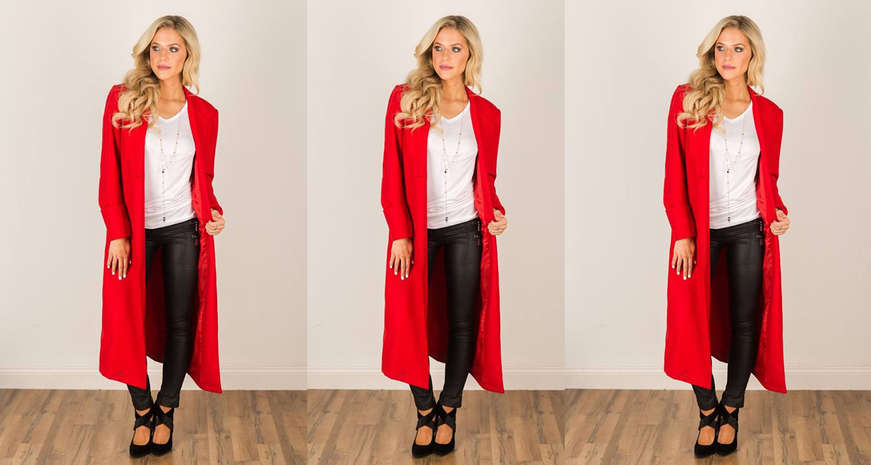 Red jacket over a white top and black pants