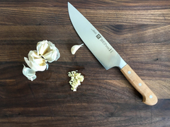 "Oak 8"" Chef's Knife on wooden cutting board"