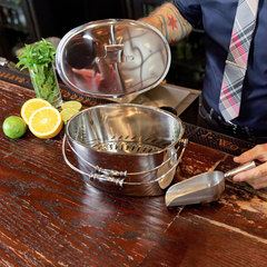 man using stainless steel ice bucket from crafthouse by fortessa in a bar
