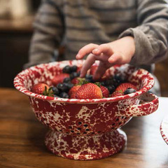 Red berry colander action shot