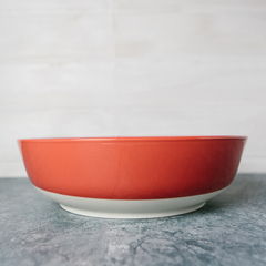 orange serving bowl with white bottom from revol