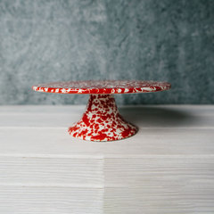 red splattered cake platter from crow canyon home