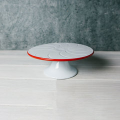 white cake stand with red rim from crow canyon home