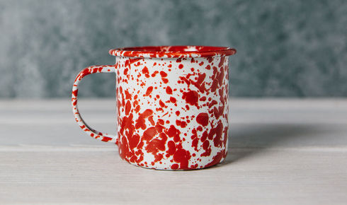 red splattered 12-ounce enamel mug from crow canyon home