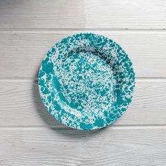 Turquoise splatter dinner plate overhead view