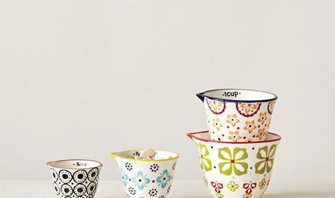 four floral patterned measuring cups stacked up from creative co-op