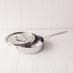 Large stainless steel saute pan with lid