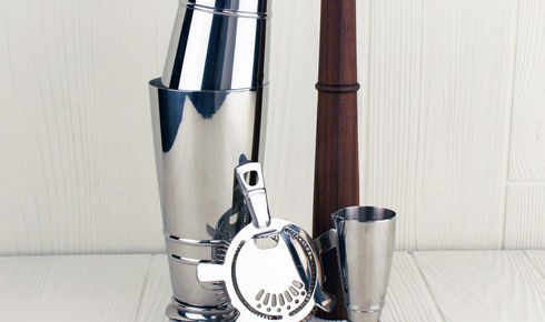 stainless steel shaker set including a two-piece shaker, two-ounce jigger, a weighted muddler, and a strainer