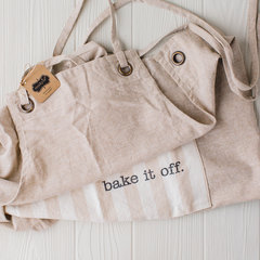 mud pie apron with bake it off written on it