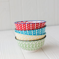 four vibrant and colorful hand-painted bowls from creative co-op stacked up