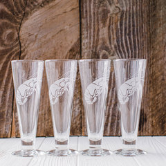Set of four Mignon Faget Crawfish Pilsners with wood background