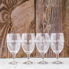 four mignon faget glass goblets with fleur-de-lis pattern