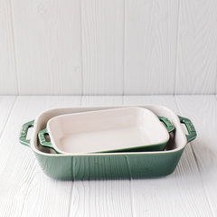 Set of two Staub baking dishes in basil color.