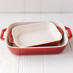 Side view of Staub's baking dish set in rustic red.