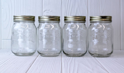 four glass mason jar preservation glasses with wide mouth
