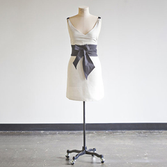 white apron with gray sash on mannequin from heirloomed
