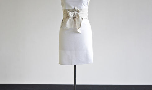 white apron with beige sash on mannequin from heirloomed