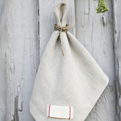 gray linen napkin hanging up outside