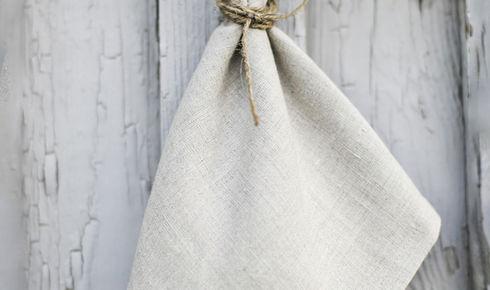 gray linen napkin hanging up outside