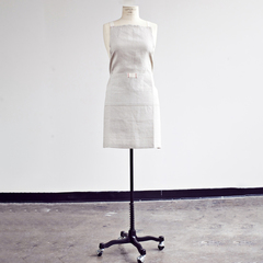 white linen apron from heirloomed on a mannequin