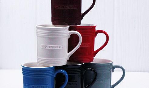 6 Mason Cash mugs of various colors.