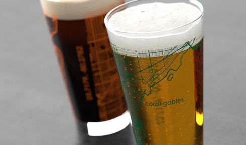 full pint glasses with map of coral gables, florida etched on