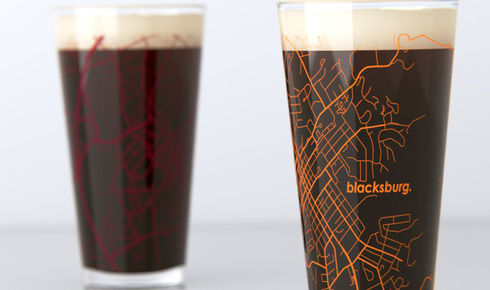two full pint glasses with map of blacksburg printed onto glass