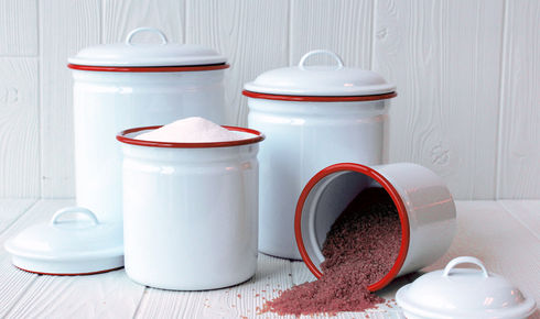 four solid white with red rim enamel canisters from crow canyon home