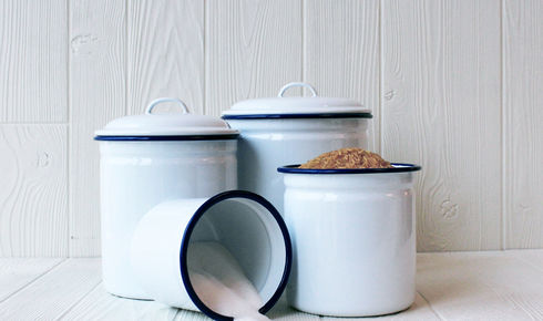 four  enamel canisters in solid white with blue rim from crow canyon home